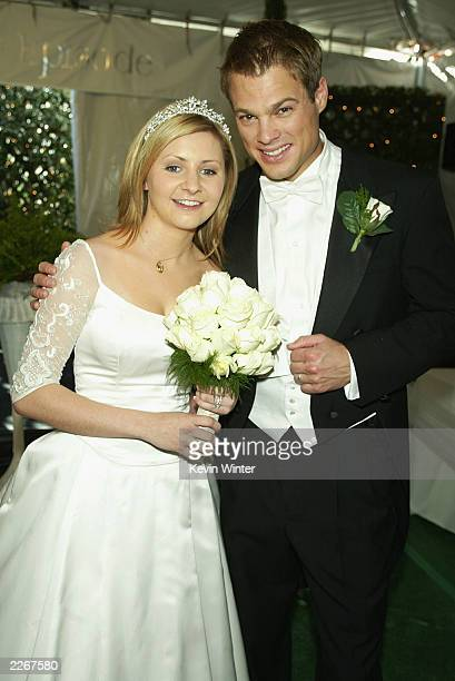 Actress Beverley Mitchell and actor George Stults who marry in a future episode pose at a reception to celebrate 150 episodes of The WB's '7th...