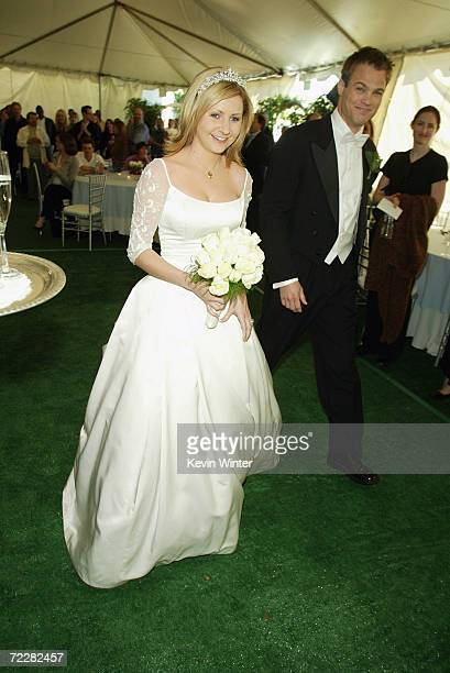 Actress Beverley Mitchell and actor George Stults who marry in a future episode arrive at a reception to celebrate 150 episodes of The WB's '7th...