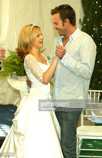 Actress Beverley Mitchell dances with her tv brother Barry Watson at a reception to celebrate 150 episodes of The WB's '7th Heaven' on February 20...