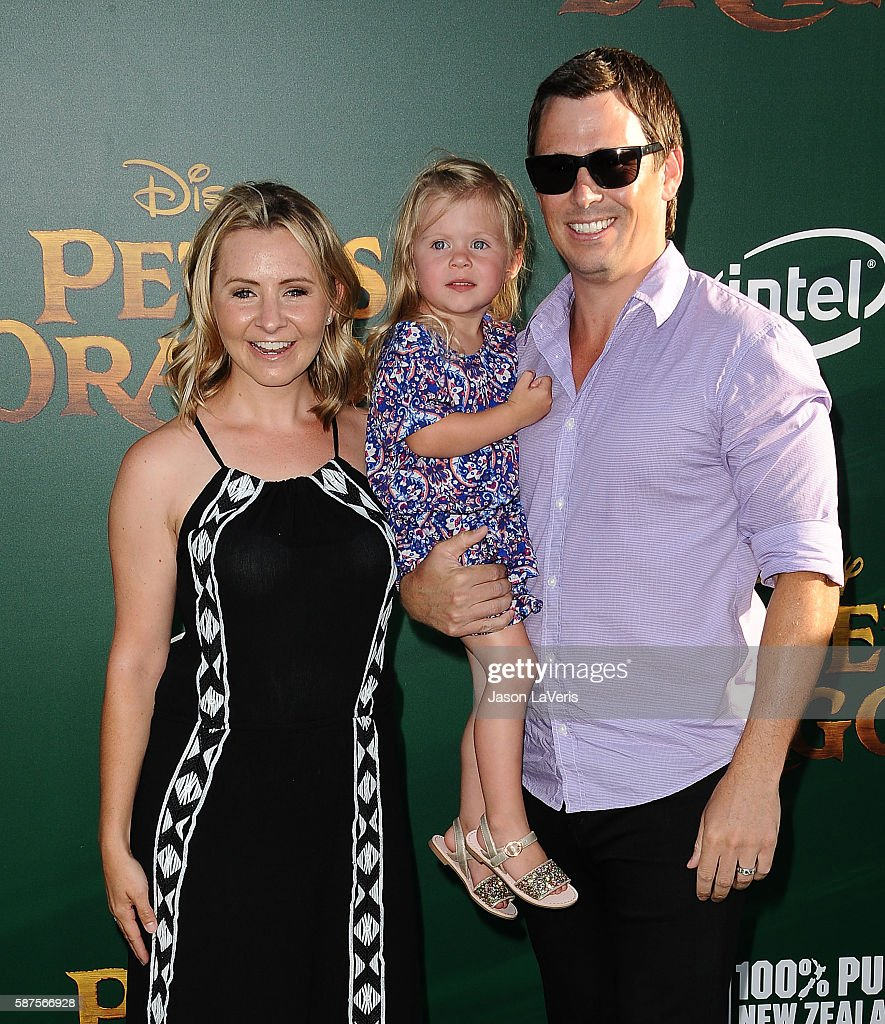 Actress Beverley Mitchell husband Michael Cameron and daughter Kenzie Cameron attend the premiere of 'Pete's Dragon' at the El Capitan Theatre on...