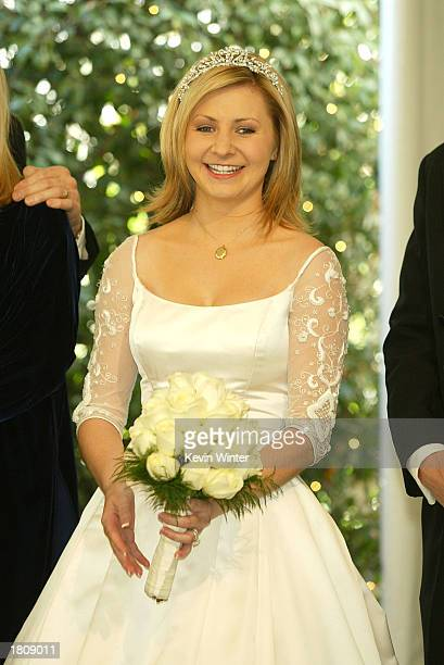 Actress Beverley Mitchell who marries in a future episode poses at a reception to celebrate 150 episodes of The WB's '7th Heaven' on February 20 2003...