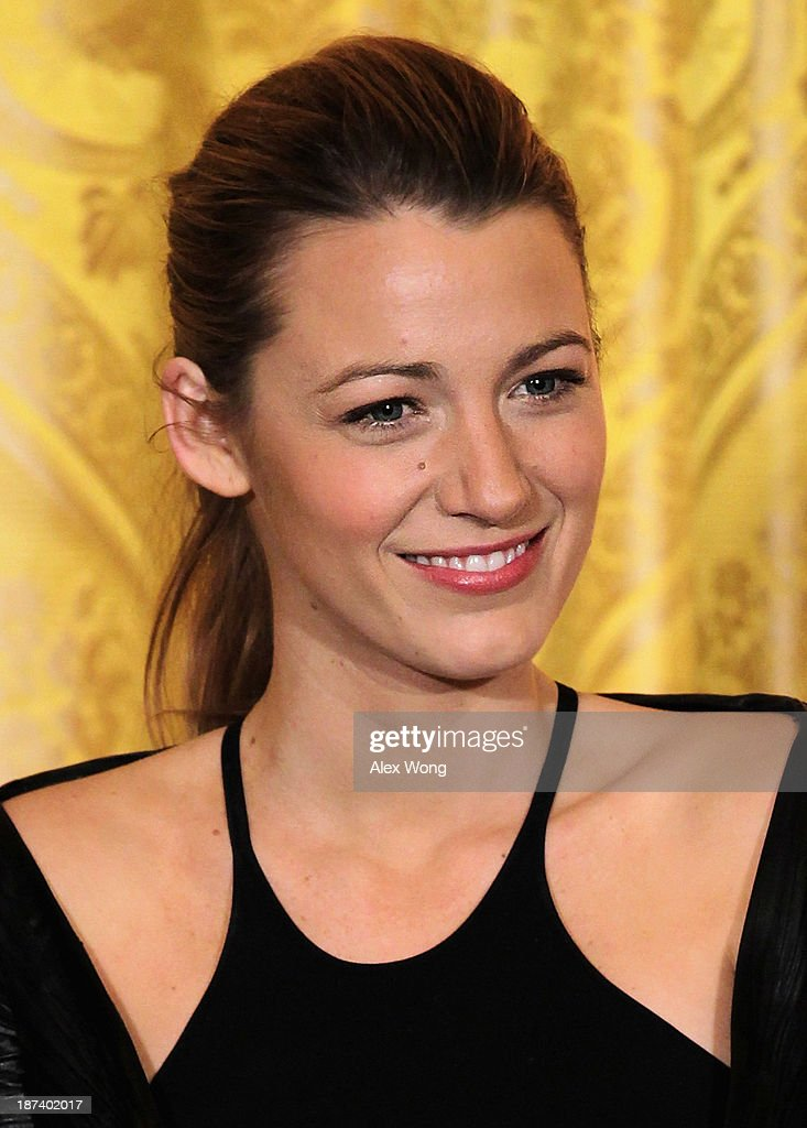 Actress <a gi-track='captionPersonalityLinkClicked' href=/galleries/search?phrase=Blake+Lively&family=editorial&specificpeople=221673 ng-click='$event.stopPropagation()'>Blake Lively</a> listens during a workshop for high school students from DC, New York and Boston about careers in film production November 8, 2013 at the East Room of the White House in Washington, DC. Students had an opportunity to hear from leaders in the industry about animation, special effects, makeup, costume, directing, music and sound effects.