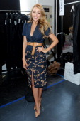 Actress Blake Lively poses backstage at the Michael Kors fashion show during MercedesBenz Fashion Week Fall 2014 at Spring Studios on February 12...