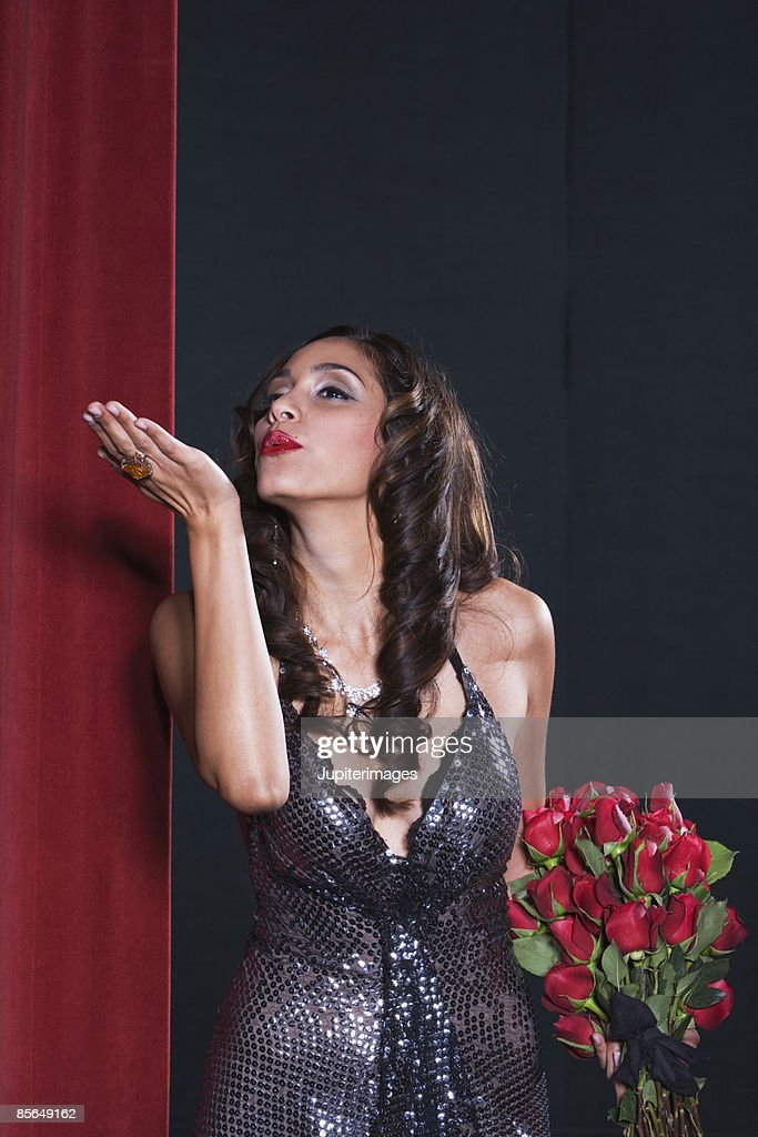 Actress blowing kisses on stage