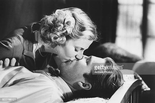 Actress Blythe Danner kissing an unknown actor in a film still for MGM Studios 1974