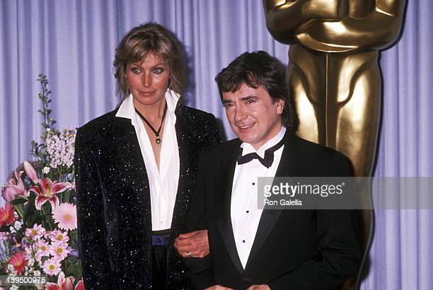 Actress Bo Derek and actor Dudley Moore attend the 61st Annual Academy Awards on March 29 1989 at Shrine Auditorium in Los Angeles California