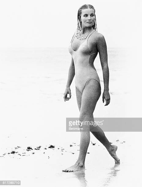 Actress Bo Derek with her hair in cornrows walks along the beach in swimwear as Samantha Taylor in the 1979 movie 10 directed by Blake Edwards
