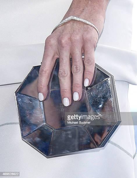Actress Bridget Regan purse and bracelet details attends The 2015 MTV Movie Awards at Nokia Theatre LA Live on April 12 2015 in Los Angeles California