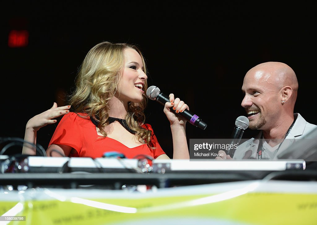 Actress Bridgit Mendler and radio personality Brian Fink speak onstage during 93.3 FLZ's Jingle Ball 2012 at Tampa Bay Times Forum on December 9, 2012 in Tampa, Florida.