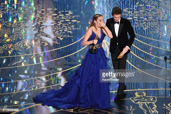 Actress Brie Larson accepts the Best Actress award for 'Room' from actor Eddie Redmayne during the 88th Annual Academy Awards at the Dolby Theatre on...