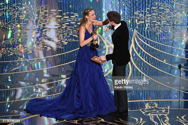 Actress Brie Larson accepts the Best Actress award for 'Room' from actor Eddie Redmayne onstage during the 88th Annual Academy Awards at the Dolby...