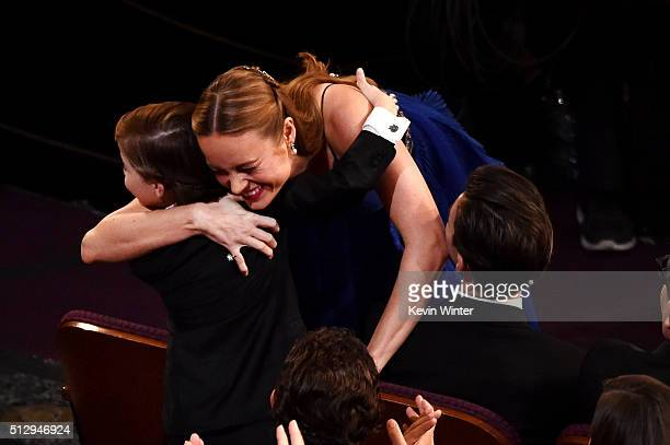 Actress Brie Larson embraces actor Jacob Tremblay after winning the Best Actress award for 'Room' during the 88th Annual Academy Awards at the Dolby...