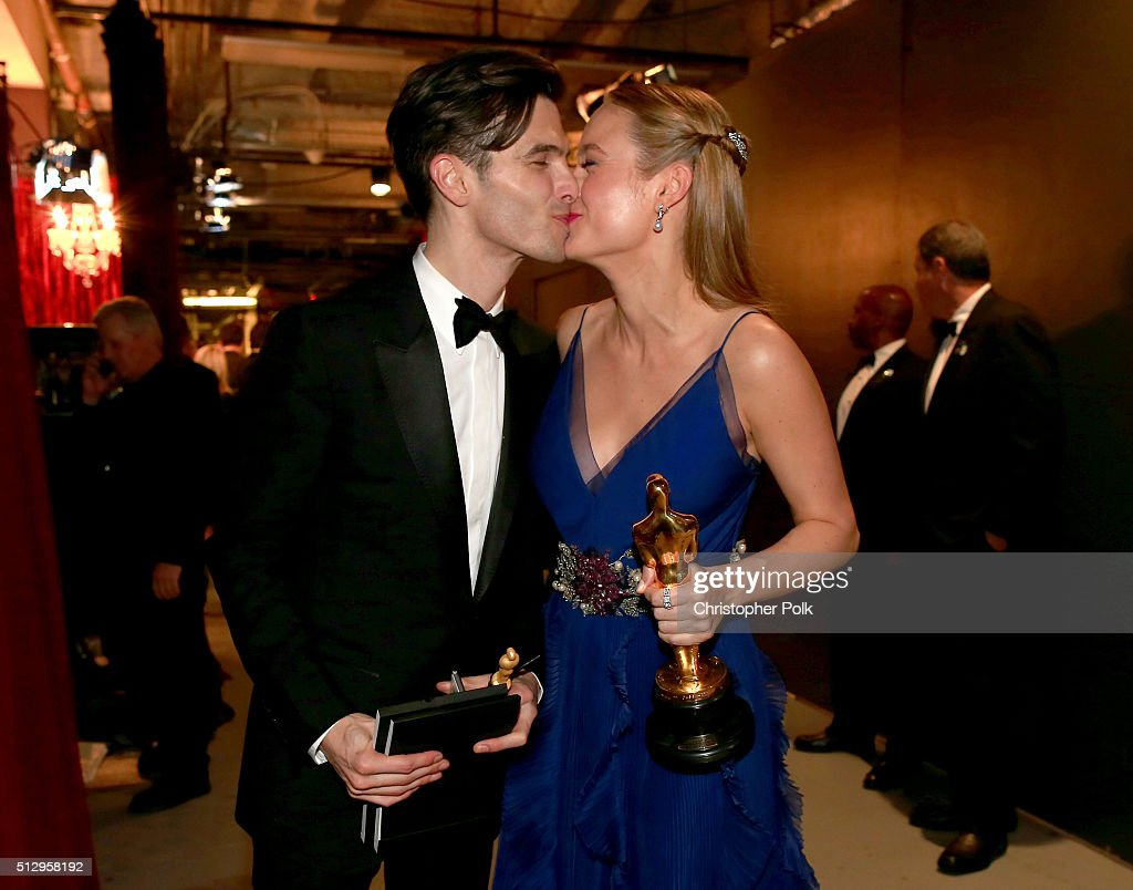 Actress Brie Larson (R), winner of Best Actress for 'Room,' and musician Alex Greenwald backstage at the 88th Annual Academy Awards at Dolby Theatre on February 28, 2016 in Hollywood, California.