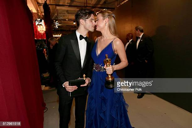 Actress Brie Larson winner of Best Actress for 'Room' and musician Alex Greenwald backstage at the 88th Annual Academy Awards at Dolby Theatre on...