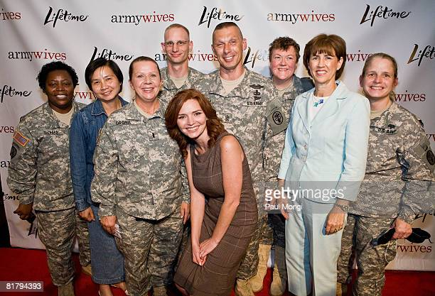 Actress Brigid Brannagh and Sheila Casey pose with soldiers from Walter Reed at the Lifetime Television screening of 'Army Wives' at Walter Reed Army...