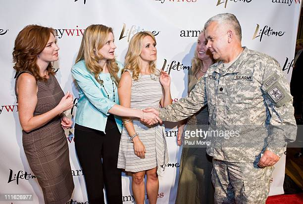 Actress Brigid Brannagh 'Army Wives' author Tanya Biank actress Sally Pressman Vivian Dietrich and Major Max Dietrich pose for a photo at the...