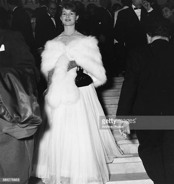 Actress Brigitte Bardot wearing a ball gown and fur stole as she attends the Cannes Film Festival April 20th 1953