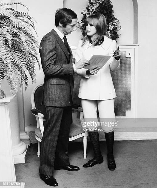 Actress Britt Ekland and fashion designer Marc Bohan discussing the Christian Dior spring collection in London February 28th 1967