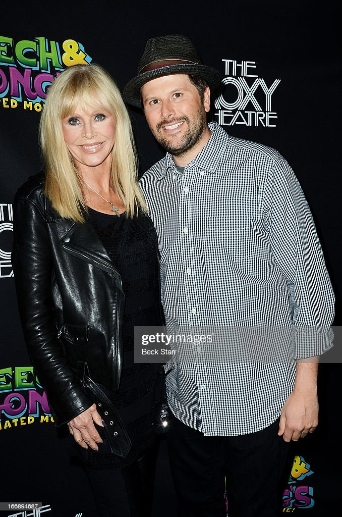 Actress Britt Ekland and Roxy co-owner Nic Adler arrive at 'Cheech And Chong's Animated Movie!' VIP green carpet premiere at The Roxy Theatre on April 17, 2013 in West Hollywood, California.