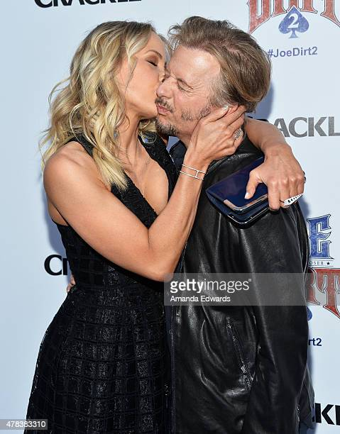 Actress Brittany Daniel and actor David Spade arrive at the world premiere of 'Joe Dirt 2 Beautiful Loser' hosted by Crackle at Sony Studios on June...