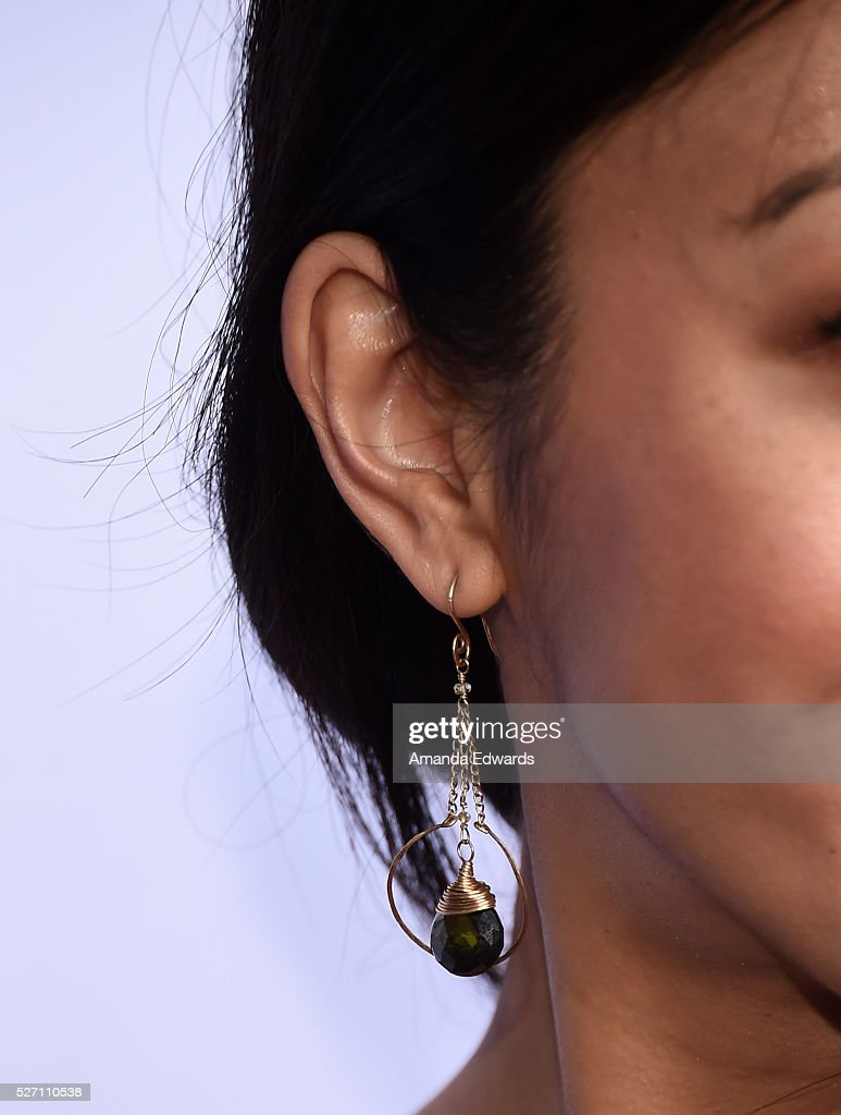 Actress <a gi-track='captionPersonalityLinkClicked' href=/galleries/search?phrase=Brittany+Ishibashi&family=editorial&specificpeople=5460200 ng-click='$event.stopPropagation()'>Brittany Ishibashi</a>, earring detail, arrives at the Netflix Original Series 'Grace & Frankie' Season 2 premiere at the Harmony Gold Theater on May 1, 2016 in Los Angeles, California.