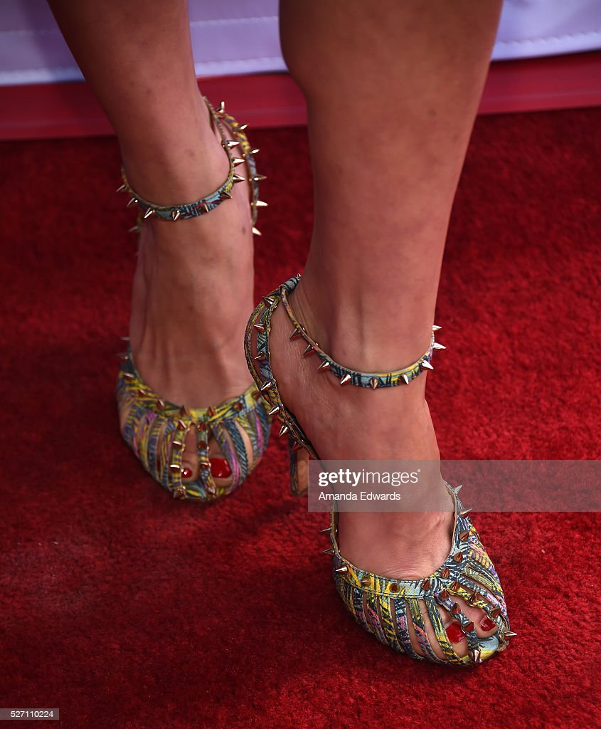 Actress <a gi-track='captionPersonalityLinkClicked' href=/galleries/search?phrase=Brittany+Ishibashi&family=editorial&specificpeople=5460200 ng-click='$event.stopPropagation()'>Brittany Ishibashi</a>, shoe detail, arrives at the Netflix Original Series 'Grace & Frankie' Season 2 premiere at the Harmony Gold Theater on May 1, 2016 in Los Angeles, California.
