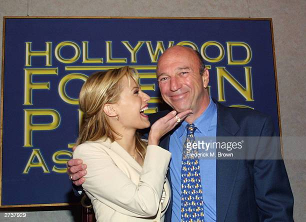 Actress Brittany Murphy and Hollywood Foreign Press Association president Lorenzo Soria attend the Hollywood Foreign Press Association press...