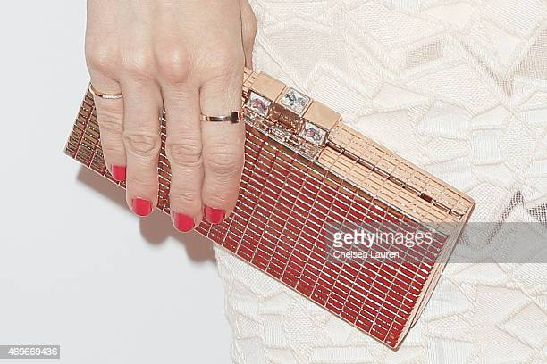 Actress Brittany Snow clutch detail arrives at the Ladygunn issue launch party at The Standard Hotel on April 13 2015 in Los Angeles California