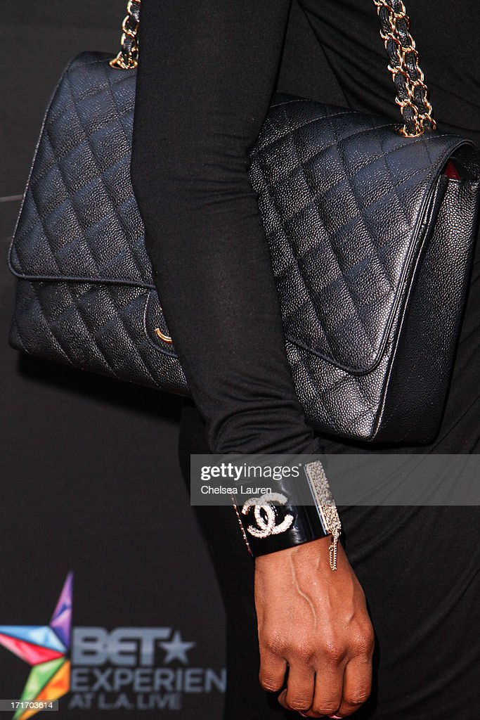 Actress Brooke Bailey (purse/jewelry detail) arrives at the 'Kevin Hart: Let Me Explain' premiere at Regal Cinemas L.A. Live on June 27, 2013 in Los Angeles, California.