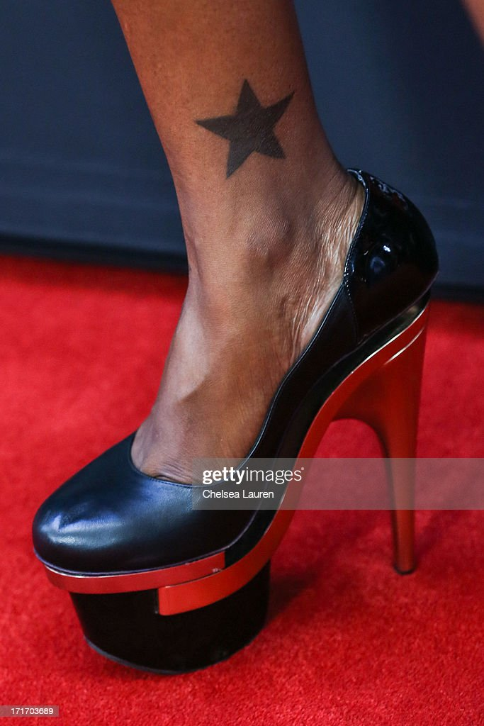 Actress <a gi-track='captionPersonalityLinkClicked' href=/galleries/search?phrase=Brooke+Bailey&family=editorial&specificpeople=4592940 ng-click='$event.stopPropagation()'>Brooke Bailey</a> (shoe detail) arrives at the 'Kevin Hart: Let Me Explain' premiere at Regal Cinemas L.A. Live on June 27, 2013 in Los Angeles, California.