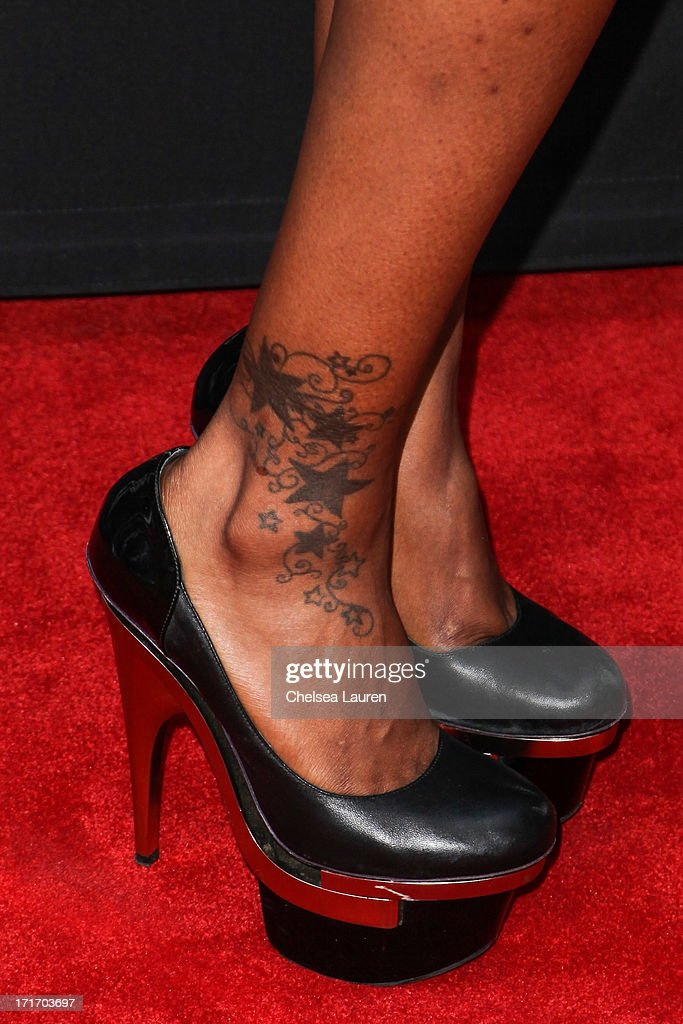 Actress <a gi-track='captionPersonalityLinkClicked' href=/galleries/search?phrase=Brooke+Bailey&family=editorial&specificpeople=4592940 ng-click='$event.stopPropagation()'>Brooke Bailey</a> (shoe/tattoo detail) arrives at the 'Kevin Hart: Let Me Explain' premiere at Regal Cinemas L.A. Live on June 27, 2013 in Los Angeles, California.