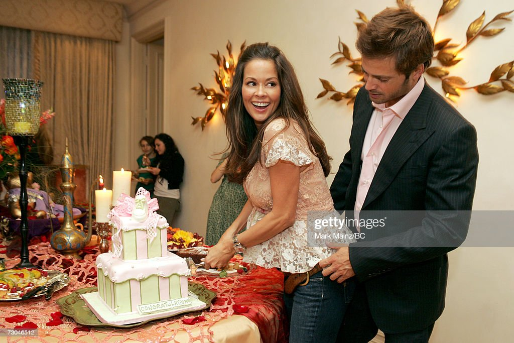 Actress Brooke Burke (L) And Fiance Actor David Charvet Cut The Cake During  The