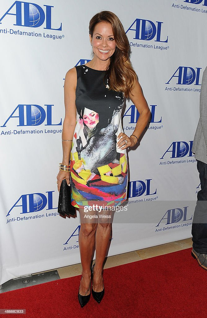 Actress <a gi-track='captionPersonalityLinkClicked' href=/galleries/search?phrase=Brooke+Burke&family=editorial&specificpeople=203216 ng-click='$event.stopPropagation()'>Brooke Burke</a> arrives at the Anti-Defamation League entertainment industry dinner honoring Roma Downey and Mark Burnett at The Beverly Hilton Hotel on May 8, 2014 in Beverly Hills, California.