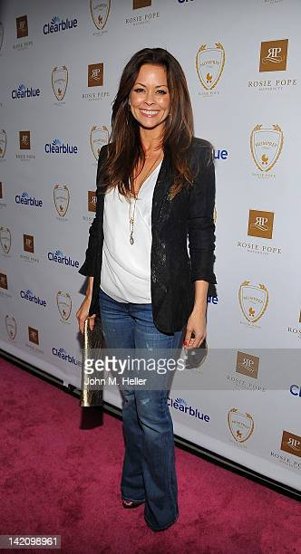 Actress Brooke Burke arrives at the opening of the Rosie Pope Maternity store on March 29 2012 in Santa Monica California