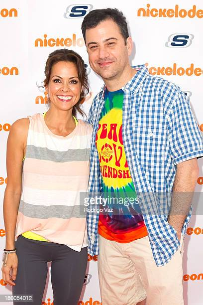 Actress Brooke Burke Charvet and comedian Jimmy Kimmel attend the 5th Annual Skechers Pier To Pier Friendship Walk on October 27 2013 in Manhattan...