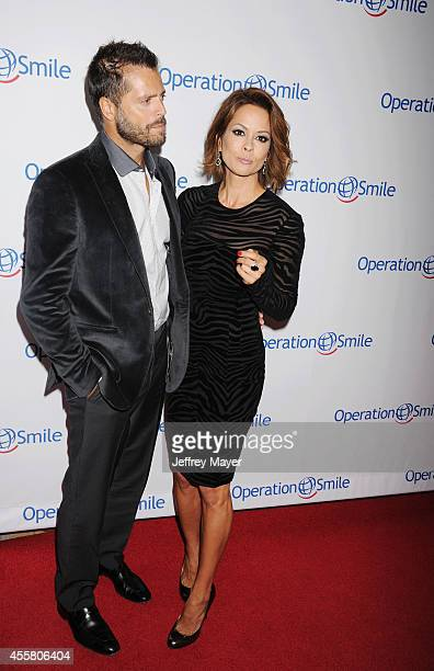 Actress Brooke BurkeCharvet and actor David Charvet attend the 2014 Operation Smile Gala at the Beverly Wilshire Four Seasons Hotel on September 19...