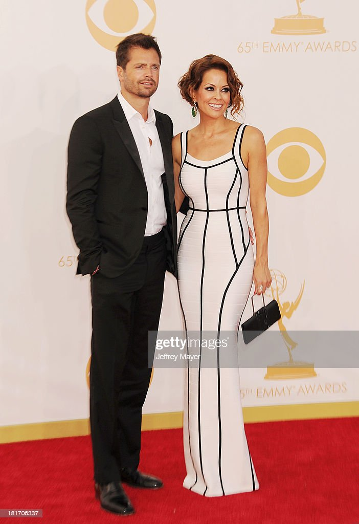 Actress Brooke BurkeCharvet and David Charvet arrive at the 65th Annual Primetime Emmy Awards at Nokia Theatre LA Live on September 22 2013 in Los...