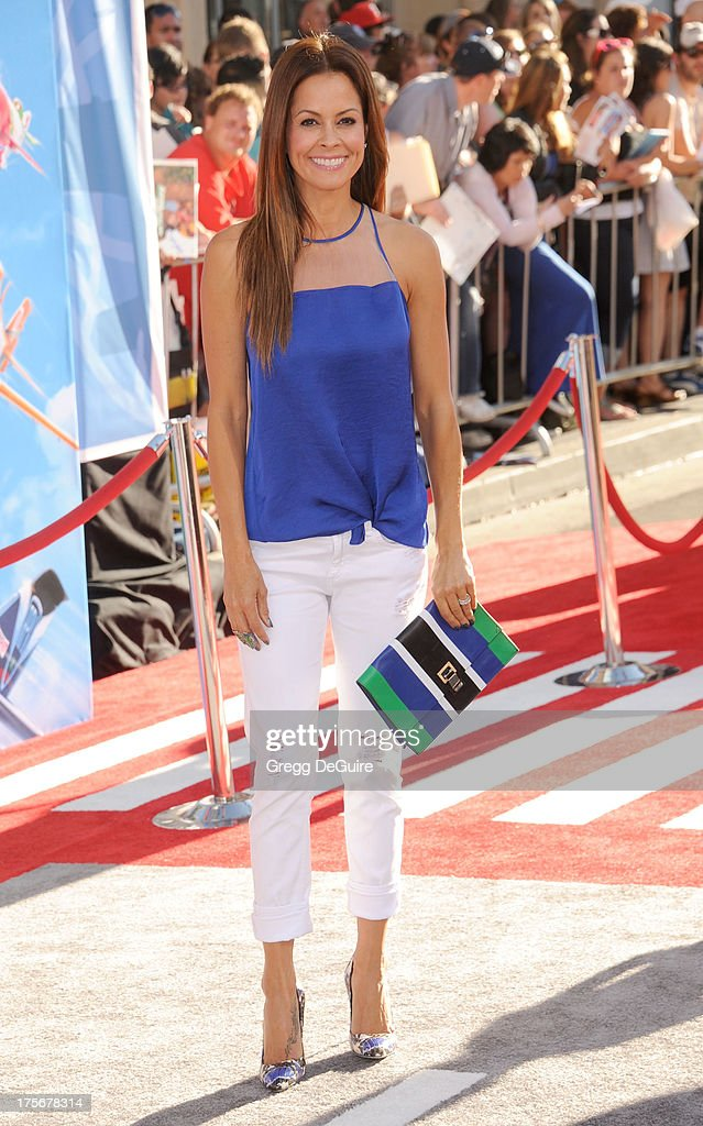Actress Brooke Burke-Charvet arrives at the Los Angeles premiere of 'Planes' at the El Capitan Theatre on August 5, 2013 in Hollywood, California.