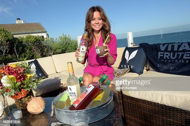 Actress Brooke BurkeCharvet attends the VitaFrute Cocktails by VEEV Coconut Colada Launch at Beach Haus Malibu on August 13 2014 in Malibu California