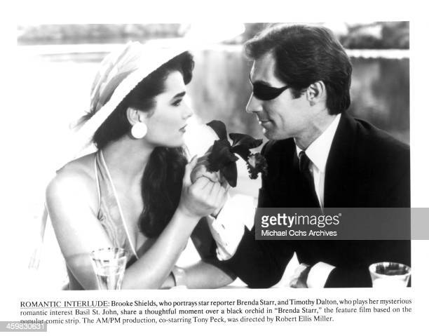 Actress Brooke Shields and actor Timothy Dalton on set of the movie 'Brenda Starr' circa 1989