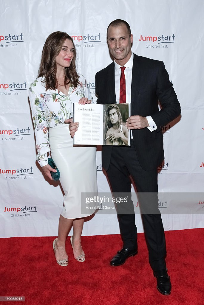 Actress Brooke Shields (L) and photographer Nigel Barker pose with Mr. Barker's newest book durng the Scribbles To Novels 10th Anniversary Gala held at Pier Sixty at Chelsea Piers on April 16, 2015 in New York City.