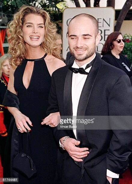Actress Brooke Shields arrives with her compatriot fiancee tennis star Andre Agassi at the 1997 Golden Globe Awards in Beverly Hills CA 19 January...
