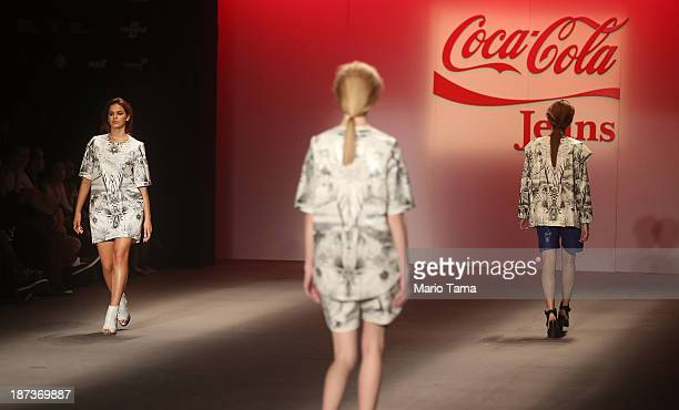 Actress Bruna Marquezine girlfriend of Brazilian football player Neymar wears a creation at the CocaCola Jeans fashion show at Fashion Rio Winter...