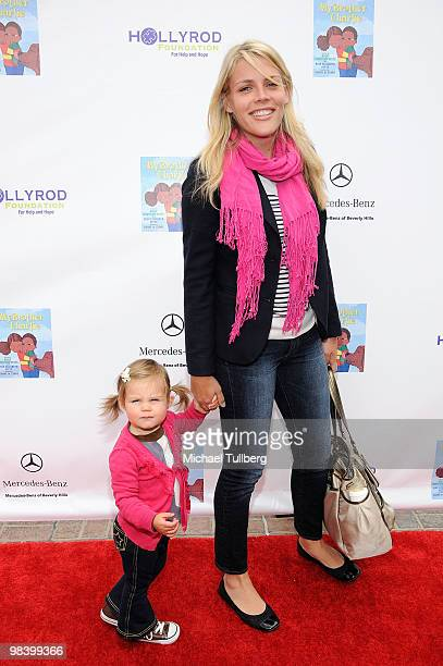 Actress Busy Philipps arrives with daughter Birdie at the launch party for actress Holly Robinson Peete's new book ''My Brother Charlie'' on April 11...