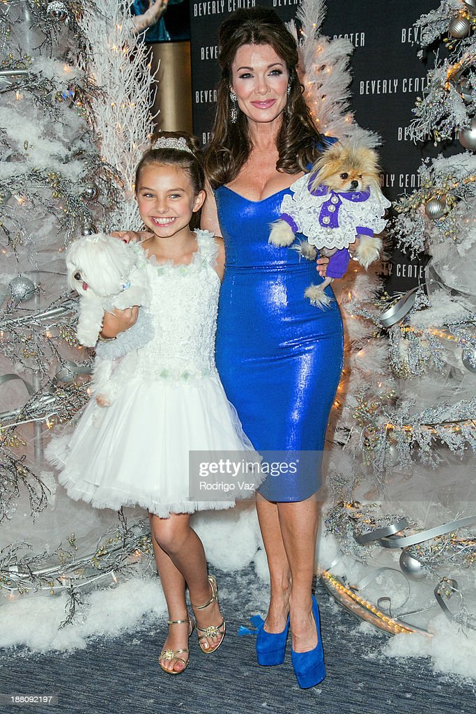 Actress Caitlin Carmichael (L) and TV personality Lisa Vanderpump attends as The Beverly Center kicks off 'Holiday Pet Portraits With Santa!' at The Beverly Center on November 14, 2013 in Los Angeles, California.