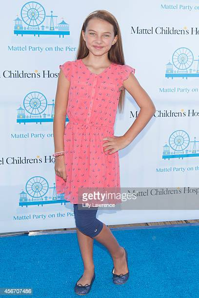 Actress Caitlin Carmichael attends Mattel's 5th Annual Party On The Pier Hosted By Sarah Michelle Gellar at Santa Monica Pier on October 5 2014 in...