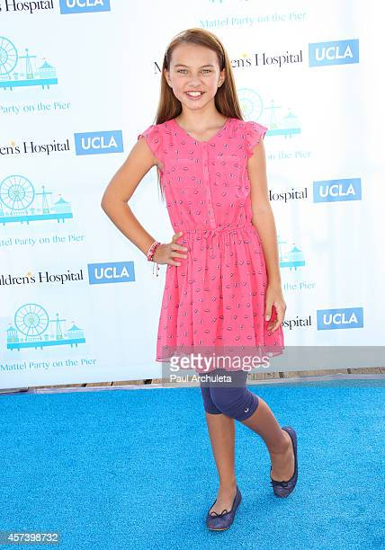 Actress Caitlin Carmichael attends Mattel's 5th annual Party On The Pier at Santa Monica Pier on October 5 2014 in Santa Monica California