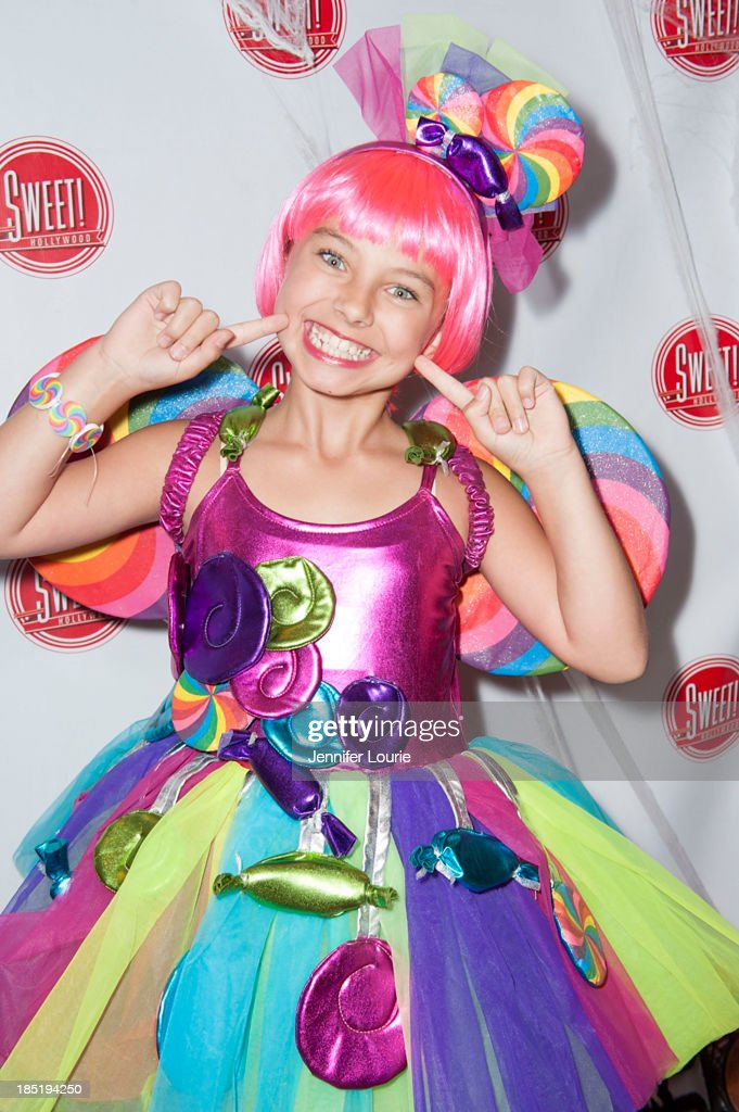 Actress <a gi-track='captionPersonalityLinkClicked' href=/galleries/search?phrase=Caitlin+Carmichael&family=editorial&specificpeople=6073013 ng-click='$event.stopPropagation()'>Caitlin Carmichael</a> attends the former Pussycat Doll Kaya Jone's 'Halloween Doll' celebratory event at Sweet! Hollywood Boutique on October 17, 2013 in Hollywood, California.
