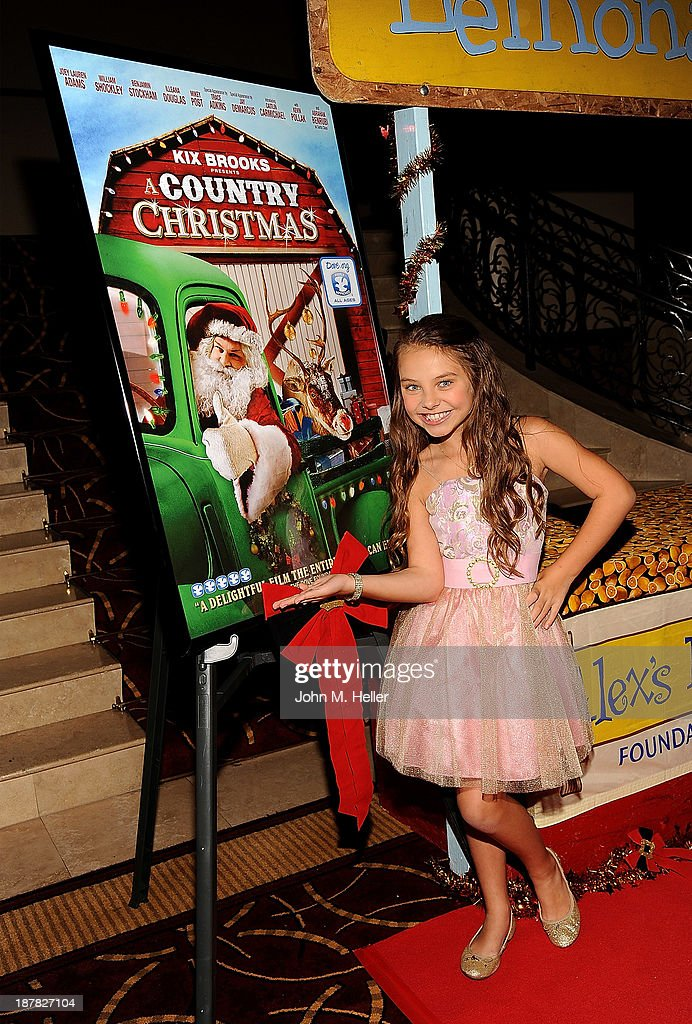 Actress Caitlin Carmichael attends the screening of 'A Country Christmas' at the Pacific Theatre at The Grove on November 12, 2013 in Los Angeles, California.