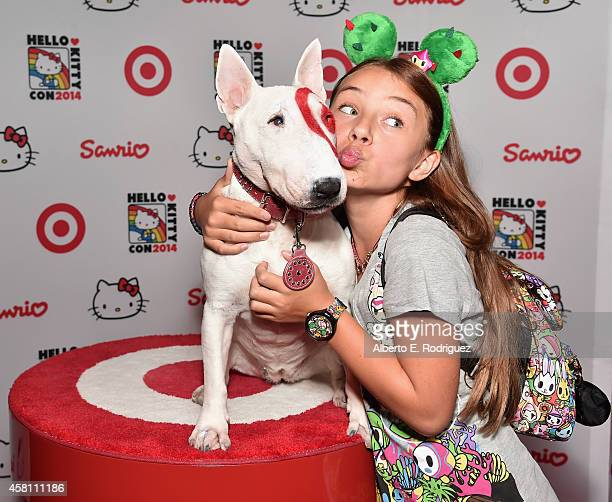 Actress Caitlin Carmichael poses with Bullseye the Target dog at Hello Kitty Con 2014 Opening Night Party Cohosted by Target on October 29 2014 in...